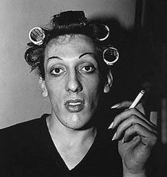 Diane Arbus:   • A young man in curlers at home on West 20th Street, N.Y.C. 1966 • © 1971 Estate of Diane Arbus  • Photo courtesy of Los Angeles County Museum of Art