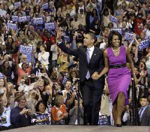 <P>Democratic presidential hopeful, Sen. Barack Obama D-Ill., arrives for an election night rally with his wife Michelle in St. Paul, Minn., Tuesday, June 3, 2008.Chris Carlson AP Photo</P>