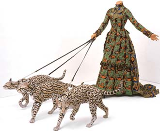 Yinka Shonibare MBE: <EM>Leisure Lady (with Ocelots),</EM> 2001Life-size fiberglass mannequin, three fiberglass ocelots,Dutch wax printed cotton, leather, glassVanhaerents Art CollectionBrussels, BelgiumImage courtesy of the artistJames Cohan Gallery, New Yorkand Stephen Friedman Gallery, London© the artistPhoto courtesy of Brooklyn Museum