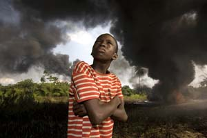 George Osodi: <EM>Oil Rich Niger Delta</EM>, 2003-2007.Photographic installation, projection of 120 digital photographs, duration: 10' loop.National Museum of Contemporary Art, Athens