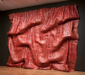 El Anatsui (Ghanaian, born 1944). <EM>Red Block</EM>, 2010Aluminum and copper wire, Two pieces, each 200 3/4 x 131 1/2 in. (509.9 x 334 cm)Courtesy of the artist and Jack Shainman Gallery, New York. Photograph by Andrew McAllister, courtesy of the Akron Art Museum