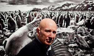 Sebastião Salgado in front of a print from <EM>Genesis</EM> Photo: David Azia/AP