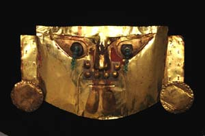 Funery Mask |750 - 1375 A.D.Lambayeque Gold, silver, amber, emerald2 3/4 × 12 3/16 × 23 1/4in. (7 × 31 × 59cm)Museo Oro del Perú, Lima T2012.70.117Photo: Seattle Art Museum.