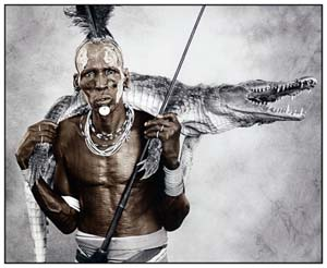 Jan C. Schlegel: <EM>Biwa (44) with Crocodile</EM>, Karo Tribe, Ethiopia 2010 Silver Gelatin Print, toned Edition of 10 50 x 60 cm, 77 x 86 cm © Jan C. Schlegel / Courtesy of Bernheimer Fine Art Photography