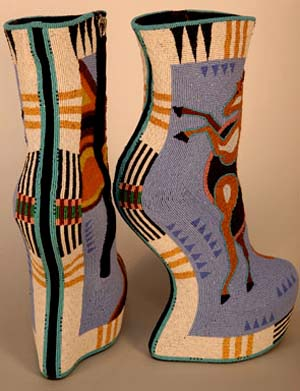 "<SPAN class=pie _extended=""true"">Jamie Okuma, b. 1977, Luiseño/Shoshone-Bannock, California. <EM>Horseshoes,</EM> 2014. Commercial shoes, glass and 24k gold beads30 ½ x 20 ¼ x 7 5/8 inches. Collection of Ellen and Bill Taubman, AI.1403.001, Photo: Cameron Linton</SPAN>"