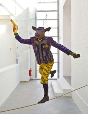 <P>Yinka Shonibare, MBE, Revolution Kid (Calf), 2012Mannequin, Dutch wax printed cotton, fibreglass, leather taxidermy calf head, Blackberry and 24 carat gold gilded gun and rope, 144.8 x 127 x 127 cm / (57 x 50 x 50 in)Photo: Christian Glaeser, 2014©the artist and courtesy of the artist and Blain|Southern</P>
