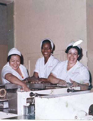 "<SPAN class=pie _extended=""true"">The artist's mother (center) working at Colombina, La Paila, Colombia, 1988Photo: Collection of Oscar Murillo</SPAN><BR _extended=""true"">"