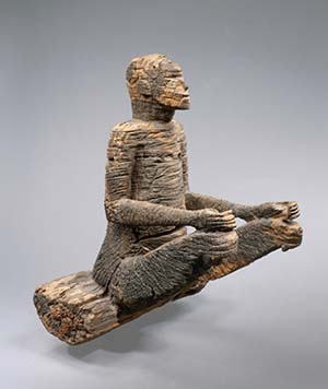 Seated figure, 17th–18th centuryMbembe peoplesEwayon River region, Cross River Province, NigeriaWood (Afzelia); H. 25 3/8 in. (64.5 cm)Musée du quai Branly, Paris (displayed at the Pavillon des Sessions, Musée du Louvre, Paris