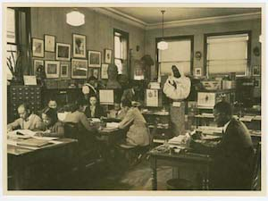Schomburg Collection reading room; Curator Lawrence Reddick at right, Schomburg staff and patrons; ca. 1930-1940s. Photographs and Prints Division, Schomburg Center for Research in Black Culture, The New York Public Library