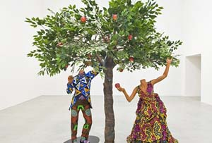 Yinka Shonibare MBE, <EM>Adam and Eve</EM> 2013Mannequins, Dutch wax cotton textile, fibreglass, wire and steel baseplate, 285x230x115cm. Copyright the artistCourtesy the artist and Stephen Friedman gallery, London and Blain | Southern, BerlinPhoto by Christian Glaeser, 2014.