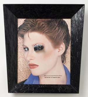 Alexis Smith: <EM>Snapshot,</EM> 1982Magazine page, wood frame, miniature camera, and glass21 3/4 x 19 3/4 in. (55.24 x 50.16 cm)Lender: Los Angeles County Museum of ArtApproved - LACMA obj