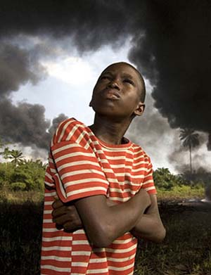"<SPAN class=pie>George Osodi: <EM>Ogony Boy</EM>, from the series ""Oil Rich Niger Delta,"" 2007Chromogenic print, 80 x 120 cm. Courtesy the artist and Z Photographic Ltd.</SPAN>"