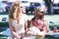 Julia Roberts as Erin Brockovich and Aaron Eckhart as George